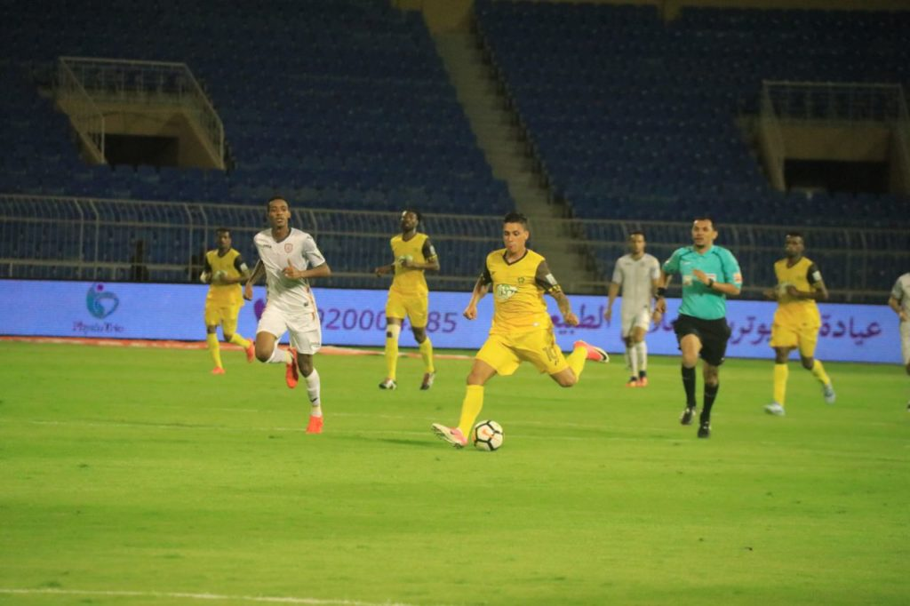 Isaac Vorsah, behind, in action for Ohod in Saudi Arabia