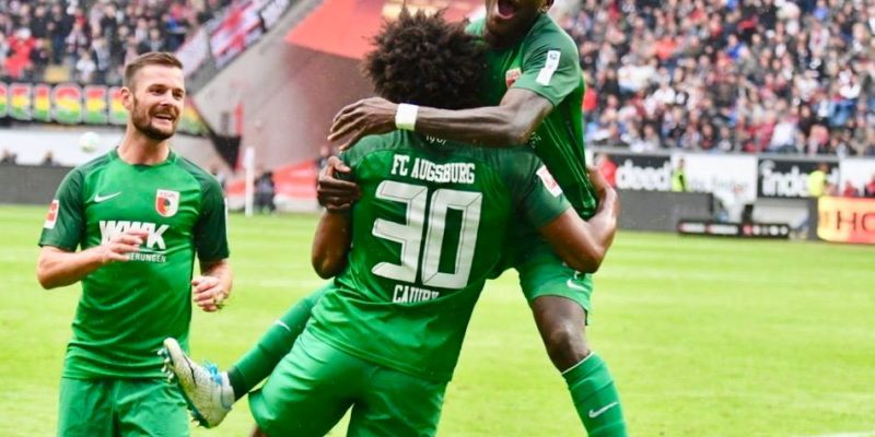Opare celebrates with Augsburg team-mate