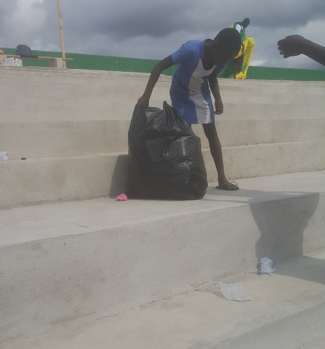 A young girl volunteering to pick and pack plastic waste after Aduana's CAF Confederation Cup with ASEC of Ivory Coast. PHOTO: El Akyereko