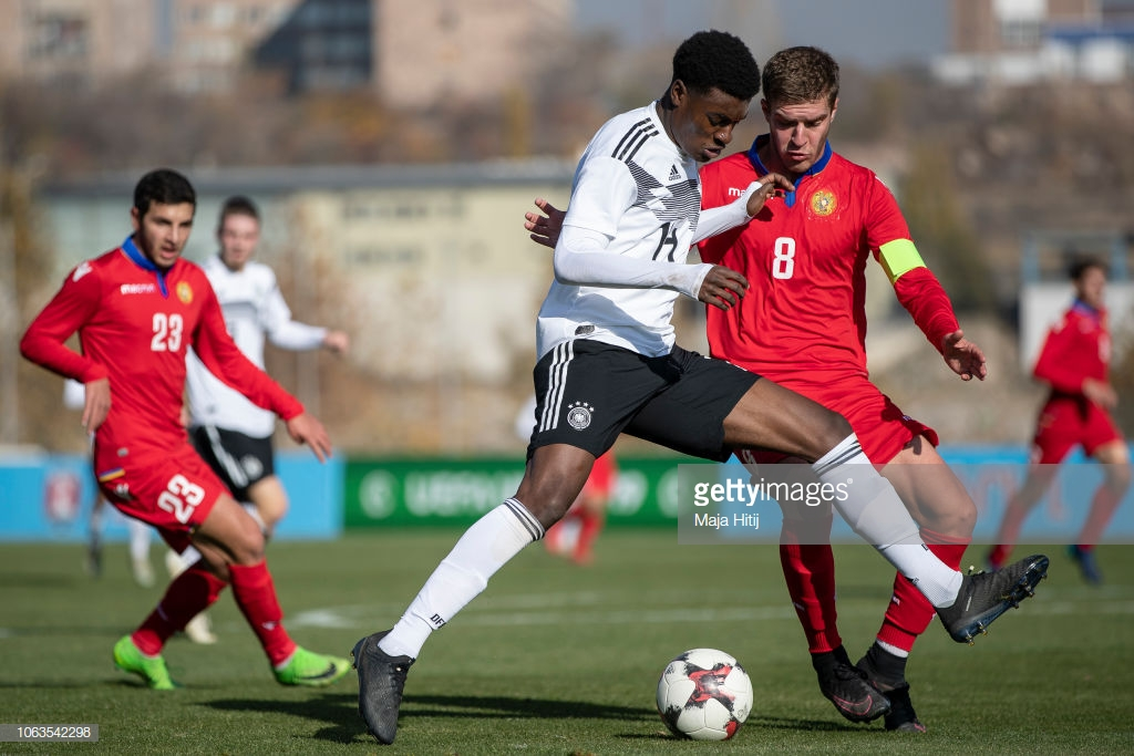 YEREVAN, ARMENIA - NOVEMBER 19: Charles-Jesaja Herrmann of Germany is challenged by Arsen Yeghiazaryan of Armenia during the Germany U19 v Armenia U19 match at UEFA Four Nations Tournament on November 19, 2018 in Yerevan, Armenia. (Photo by Maja Hitij/Bongarts/Getty Images)